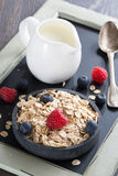 Healthy food - cereal, fresh berries and jug of milk, close-up. Vertical Stock Photography