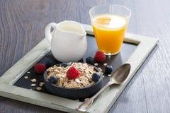 Healthy food - cereal, fresh berries, milk and orange juice Stock Photos