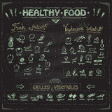 Healthy food chalkboard menu with hand drawn assorted fruits and vegetables. Royalty Free Stock Image