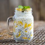 Healthy food, chia seed pudding with mango, oat flakes, coconut milk and muesli, vitamin breakfast in glass mug. Morning in Thaila Royalty Free Stock Images