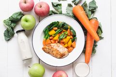 Healthy food chicken breast and vegetables White wood background Royalty Free Stock Image
