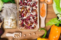 Healthy food clean eating , legume, garlic, onion broccoli, chickpea, lentils, beans in wooden board stock photo