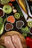 Healthy food clean eating selection. fruit, vegetable, seeds, superfood, cereals, leaf vegetable on rustic background stock photography