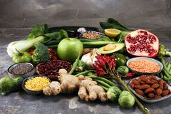 Healthy food clean eating selection. fruit, vegetable, seeds, superfood, cereals, leaf vegetable on rustic background royalty free stock images