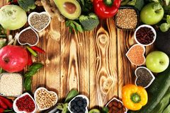 Healthy food clean eating selection. fruit, vegetable, seeds, superfood, cereals, leaf vegetable on rustic background royalty free stock photos