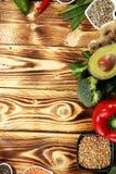 Healthy food clean eating selection. fruit, vegetable, seeds, superfood, cereals, leaf vegetable on rustic background royalty free stock image