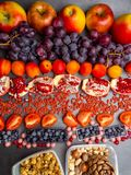 Healthy food clean eating selection: fruits,, superfood, nuts on gray concrete background stock photo