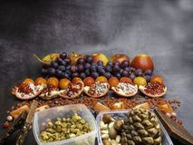 Healthy food clean eating selection: fruits,, superfood, nuts on gray concrete background royalty free stock photography