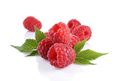 Healthy food. Close up view fresh ripe raspberry with leaves. Isolated on white background Royalty Free Stock Images