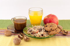 Healthy Food and Coffee. Healthy breakfast of oatmeal, cinnamon, fruit, nuts cookies and a glass of orange juice and coffee on a white background stock photo