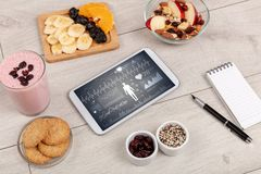 Healthy food composition with tablet Royalty Free Stock Images