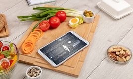 Healthy food composition with tablet royalty free stock image
