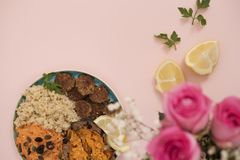 Healthy food concept. Clean eating. Meal with turkey meatballs, bulgur, sweet potato, carrot, salad. Pink and gold concept. Low ca Royalty Free Stock Photo