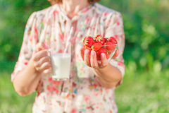 Healthy food concept: close up of a female hand with a milk Stock Photos