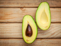 Healthy food concept.Closeup ripe avocado on wooden background. Royalty Free Stock Photos
