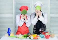 Healthy food concept. Couple cooking healthy vegetarian meal. Vegetarian family. Vegetarian nutrition and vegetable diet. Diet on their mind. Couple cooks hold royalty free stock photography
