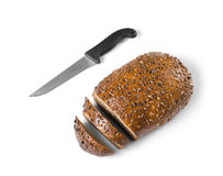 Healthy food concept. Cut loaf of wholemeal bread and knife isolated on white background as a healthy eating concept Royalty Free Stock Image