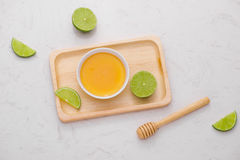 Healthy food concept. Fresh lime with honey on table Royalty Free Stock Image