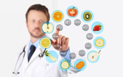 Healthy food concept, Hand of nutritionist doctor pointing fruit stock images