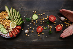 Healthy food concept. Hands and healthy salad with chickpea and stock images