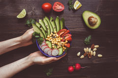 Healthy food concept. Hands holding healthy salad with chickpea and vegetables. Vegan food. Vegetarian diet stock photos