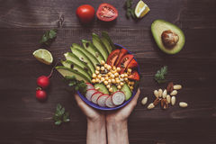 Healthy food concept. Hands holding healthy salad with chickpea stock photography