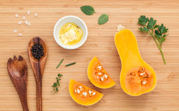 Healthy food concept. Ingredients for pumpkin soup on bamboo cut Royalty Free Stock Photo