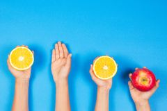 Healthy food concept. Many kids hands with fuits. Top view. Healthy food concept. Many kids hands with fuits on blue background. Top view royalty free stock photos
