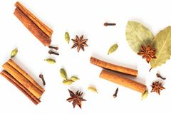 Healthy food concept Mix of organic spices star anise, cinnamon, bay and cardamom pods on white background stock images