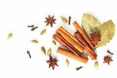 Healthy food concept Mix of organic spices star anise, cinnamon, bay and cardamom pods on white background stock photos