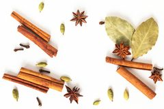 Healthy food concept Mix of organic spices star anise, cinnamon, bay and cardamom pods on white background royalty free stock photos