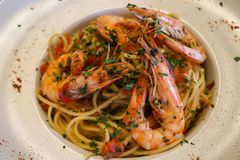 Healthy food concept. Spaghetti with shrimps, prawns on white plate. Close up view. stock image