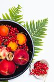 Healthy food concept Summer fruits Peach, apricot and red currant burry in pie pan stock photo