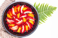 Healthy food concept Summer fruits Peach, apricot and red currant burry in pie pan stock photography