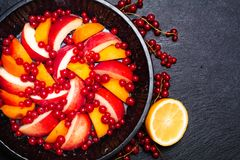 Healthy food concept Summer fruits Peach, apricot and red currant burry in pie pan royalty free stock photos