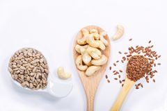 Healthy food concept top view sunflower seeds, cashew nuts and flax seeds Royalty Free Stock Images
