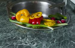 Washed fresh vegetables lie on the kitchen sink Royalty Free Stock Photography