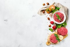 Homemade raw organic minced beef meat burger cutlet and vegetables. Healthy food, cooking concept. Homemade raw organic minced beef meat and burger steak cutlet Royalty Free Stock Images