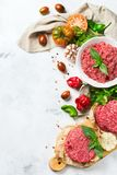 Homemade raw organic minced beef meat burger cutlet and vegetables. Healthy food, cooking concept. Homemade raw organic minced beef meat and burger steak cutlet Royalty Free Stock Photo