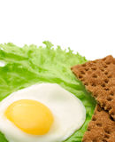 Healthy food copy space: fried eggs, lettuce, crisp bread Royalty Free Stock Photo