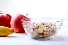 Healthy food with Corn Flakes cereal in a bowl, apple, banana and glass with milk. Morning breakfast. Healthy food with Corn Flakes cereal in a bowl, apple stock photos