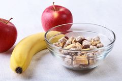 Healthy food with Corn Flakes cereal in a bowl, apple, banana and glass with milk. Morning breakfast. Healthy food with Corn Flakes cereal in a bowl, apple royalty free stock photography