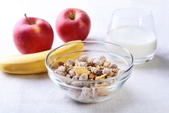 Healthy food with Corn Flakes cereal in a bowl, apple, banana and glass with milk. Morning breakfast. Healthy food with Corn Flakes cereal in a bowl, apple royalty free stock photos