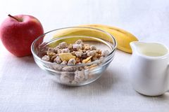 Healthy food with Corn Flakes cereal in a bowl, apple, banana and glass with milk. Morning breakfast. Healthy food with Corn Flakes cereal in a bowl, apple stock photography
