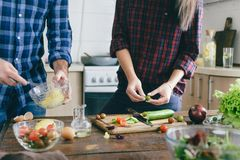 Healthy food. Couple preparing summer salad home kitchen. Healthy food. Couple preparing summer salad at home in the kitchen Stock Photos