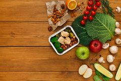 Healthy food delivery background, lunch box on rustic wood Royalty Free Stock Photo