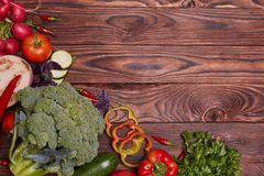 Fresh Vegetables on brown wooden background. Healthy food delivery background. Lunch layout with colorful vegatables Stock Images