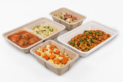 Healthy food delivery. For fitness nutrition or diet. Daily meals in paper boxes on a white background Royalty Free Stock Image