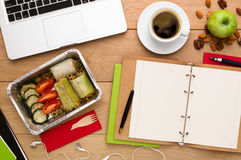 Healthy food delivery, lunch box with diet meal. Healthy food delivery. Lunch box with diet meal on workplace, flat lay of wooden desktop with foiled container Stock Photo