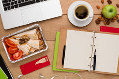 Healthy food delivery, lunch box with diet meal. Healthy food delivery. Lunch box with diet meal on workplace, flat lay of wooden desktop with foiled container Royalty Free Stock Photography